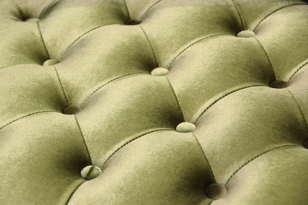 button tufted: Green button-tufted Fabric background Stock Photo
