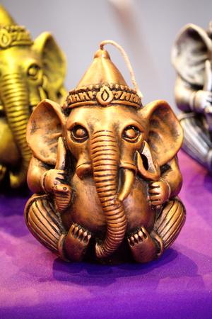 headed: Elephant Headed God Handicraft Candle in Thai Local Market Stock Photo