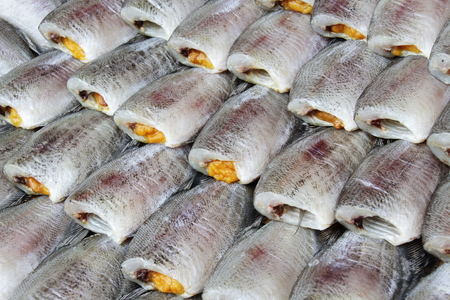 desiccation: Thai Dried Salted Fish Making - Snakeskin gourami in the Food Market in Thailand