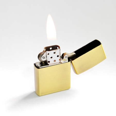 gas lighter: Closed Up Zippo Lighter with Flame Isolated on White Background Stock Photo