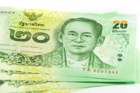 affluence: Closed up Thai banknote twenty baht isolated on white background