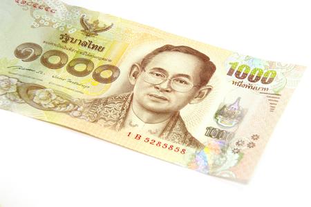 profiting: Closed up Thai banknote thousand baht isolated on white background Stock Photo