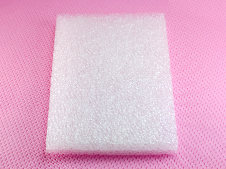 absorb: Shockproof material Polyethelene foam on pink background