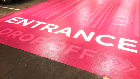 drop off: Entrance text and drop off sign on pink floor