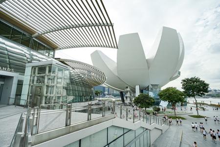 MARINA BAY, SINGAPORE - JAN 20, 2017: Landscape of ArtScience Museum nearly to The Shoppes at Marina Bay Sands. ArtScience Museum is a famous scene of Singapore travel destination.