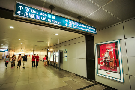 MARINA BAY, SINGAPORE - JAN 20, 2017: In the Marina Bay station, people walking on walkway. This Singapore MRT station is the nearest station to go to The Marina Bay Sands.
