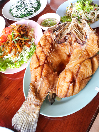 Deep fried barramundi or white perch or snapper with fish sauce