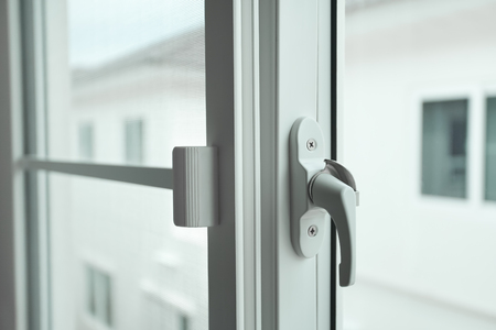 Pleas close the window, closed up plastic window and handle Stock Photo