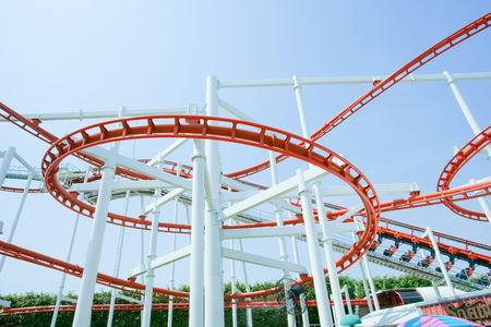 Funny with Roller Coaster in amusement park, so excited.