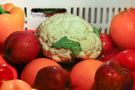 Look into the refrigerator fresh vegetable and fruit scene Stock Photo