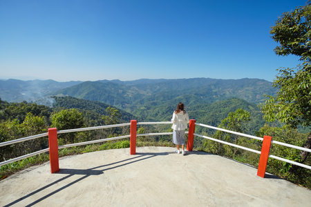 Asian woman tourist on view point in Doi Mea Salong, Chiang Rai Thailand