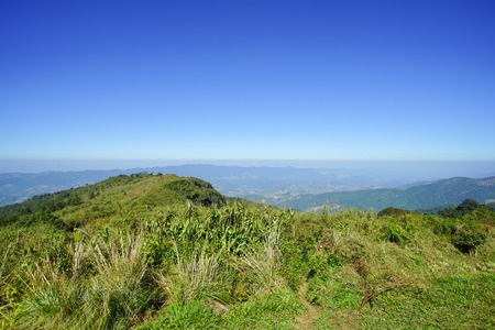 Mountain, forest and blue sky in Phu Chee Fa, Chiang Rai Thailand Stock Photo