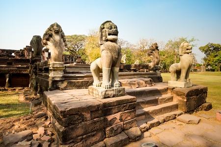Lion or Singha and Naga sandstone statue in Prasat Hin Phimai of Phimai historical park. Stock Photo