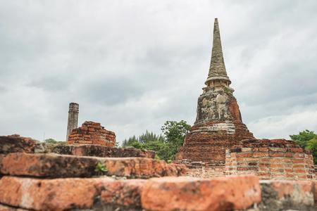Old pagoda in Wat Mahathat, Ayutthaya historical park, Thailand.
