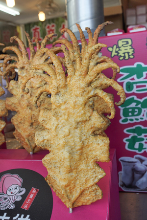 New Taipei, Taiwan - November 24, 2018: The famous Taiwanese fried squid in Tamsui old street, New Taipei, Taiwan.