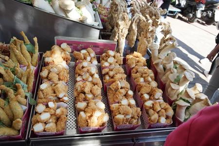 New Taipei, Taiwan - November 24, 2018: The famous Taiwanese fried seafood in Tamsui old street, New Taipei, Taiwan.