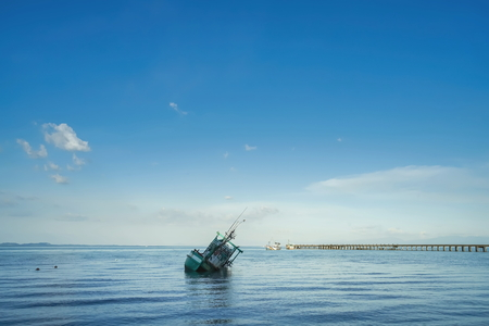 Loneliness scene of sunken ship in Koh Chang, Trad province, Thailand.