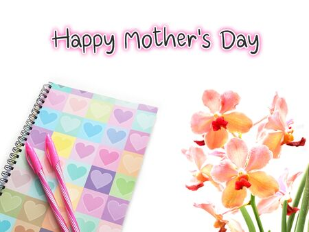Happy mother's day text on white background with colorful diary and pink orchid. Banco de Imagens