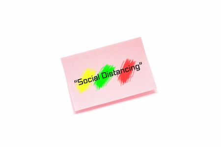 Social distancing text with color splash on pink notepad isolated on white background.