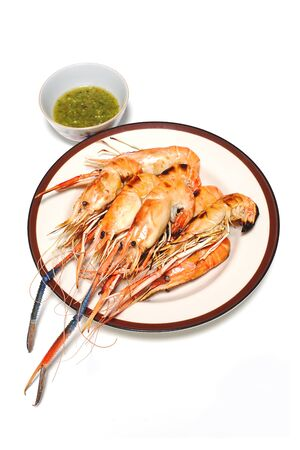 Grilled Shrimps on plate with Thai Seafoods Dipping Sauce. on white background.