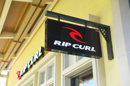 Samut Prakan, Thailand - June 13, 2020: Logo of RIP CURL in Central Village, Samut Prakan, Thailand. Rip Curl is a designer, manufacturer, and retailer of surfing sportswear and casual wear.