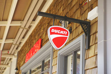 Samut Prakan, Thailand - June 13, 2020: Logo of Ducati Motor in Central Village, Samut Prakan, Thailand. This brand is the Italian motorcycle manufacturer headquartered in Bologna, Italy.