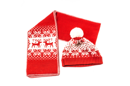 The christmas scarf and the bonnet on the white background. The objects are isolated on white and a clipping path is provided for easy extraction.
