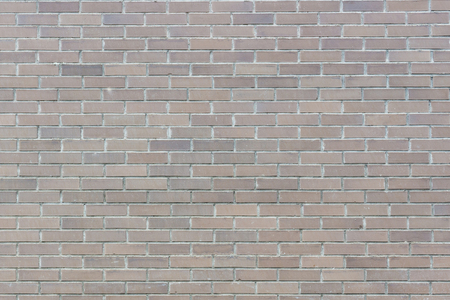 The dirty brown brick wall background texture