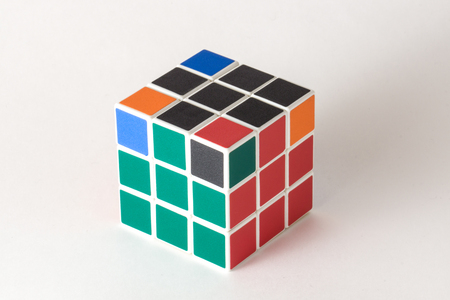 The Rubik's cube on the white background. The solution sequence stage six