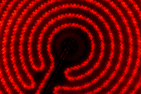 The hob of cooktop. Glowing spiral on the black background Stock fotó