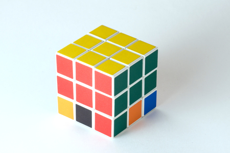 The Rubiks cube on the white background. The solution sequence stage three