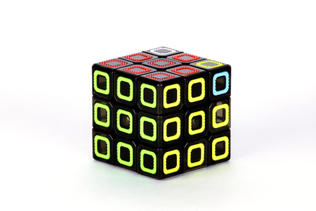The Rubik's cube on the white background. The solution sequence stage nine. The object is isolated on white and a clipping path is provided for easy extraction.