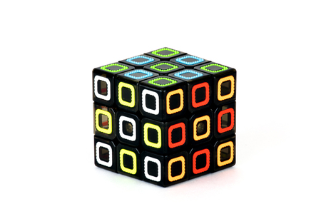 The Rubiks cube on the white background. The way of solution. The object is isolated on white and a clipping path is provided for easy extraction. 版權商用圖片