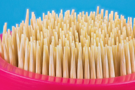 The toothpick set or kit. Toothpicks are in the special box or case. The macro shot is made by means of stacking technology Фото со стока
