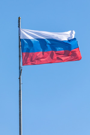 The government flag of Russia on the sky background.