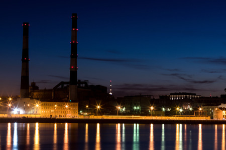 The evening thermal power station on the Neva river embankment in Saint Petersburg, Russia