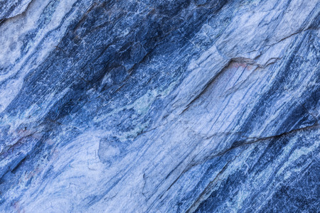 The background or texture of the marble wall of the quarry or opencast. The surface of the marble stone or rock