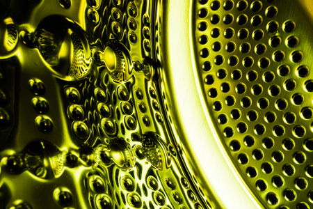 The texture of the cylinder or barrel of the washing machine. The abstract background in the vivid green color Banque d'images - 109653828