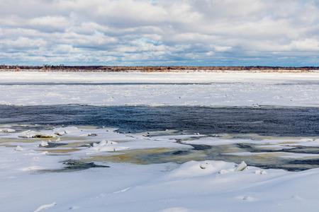 Hummocks on the winter river Stockfoto