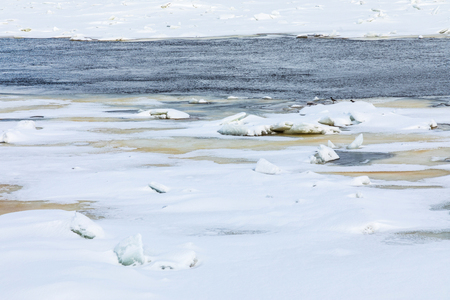 Hummocks on the winter river Standard-Bild