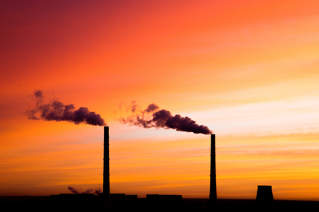 Silhouettes of pipes of thermal power station Standard-Bild