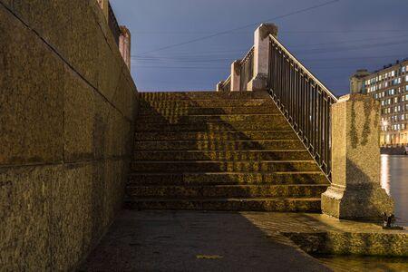 Stairway of the granite embankment Stock Photo