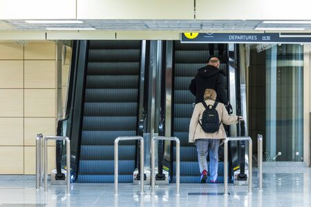 People on airport escalator