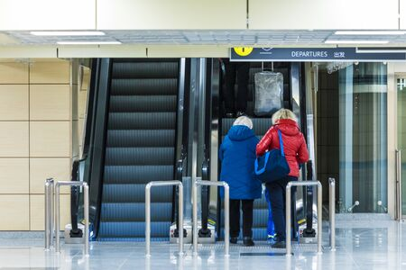 People on the departure escalator