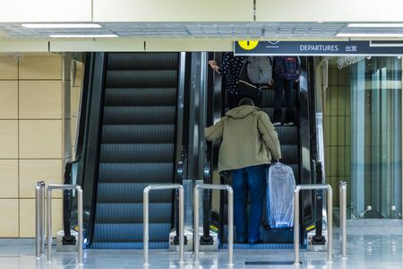 People on the escalator or moving staircase