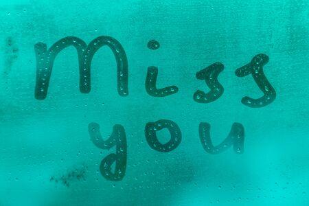 Inscription mis you on evening window glass