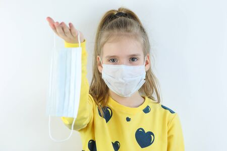 Beautiful girl offering off medical helthcare mask Stock Photo