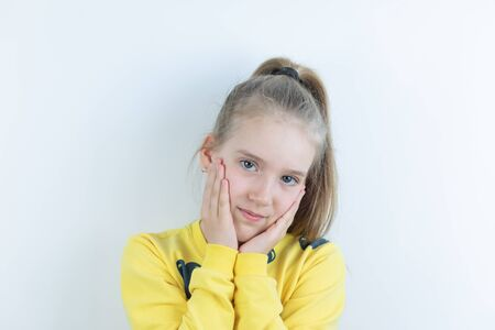 Girl in yellow sweater in disappointing or regret pose Banque d'images