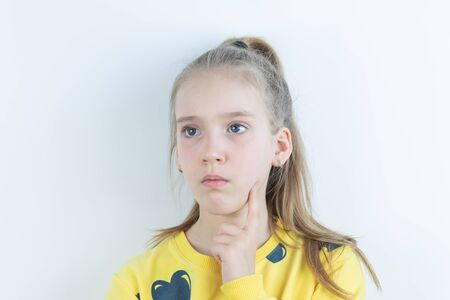 Girl in yellow sweater in thoughtful or dreamy pose