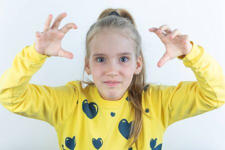 Girl in yellow sweater in threatening pose